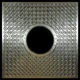 Di piastra metallica con i fori sulla foto di concetto del nero dell'isolato Fotografia Stock