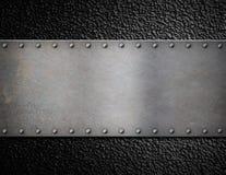 Di piastra metallica con il fondo dei ribattini Immagini Stock