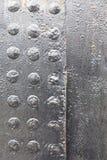 Di piastra metallica e ribattini Fotografia Stock