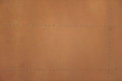 Di piastra metallica marrone chiaro con i ribattini per il lerciume o il fondo astratto Immagini Stock