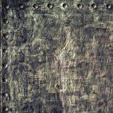 Di piastra metallica nero di lerciume con i ribattini avvita la struttura del fondo Fotografie Stock Libere da Diritti