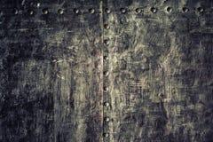 Di piastra metallica nero di lerciume del primo piano vecchio come struttura del fondo Fotografia Stock