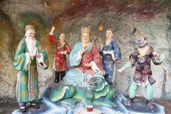 Di Zang Wang Buddha con la diorama de los asistentes Imágenes de archivo libres de regalías