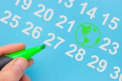 Dia da Terra marcado no calendário imagens de stock