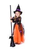 Dia das Bruxas: Bruxa mal-humorada da menina imagens de stock