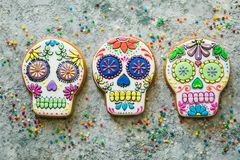 Dia de los muertos concept - skull shaped cookies with colorful decorations stock images