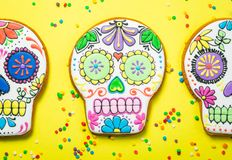 Dia de los muertos concept - skull shaped cookies with colorful decorations Royalty Free Stock Photo