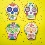Dia de los muertos concept - skull shaped cookies with colorful decorations Royalty Free Stock Images