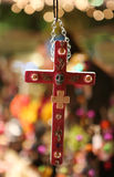 Dia de los Muertos Cross. Photo of a decorated cross hangs in a shop during a Dia de los Muertos festival in Las Vegas, NV, USA. Lights and colors can be seen at Stock Image