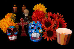 Dia De Los Muertos (Day of the Dead) Altar. With decorated sugar skulls, marigold flowers, candles, and cross. Traditional Mexican offering to loved ones Stock Image