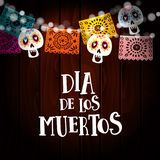 Dia de los Muertos, Day of the Dead or Halloween card, invitation with string of lights, sculls and paper cut party. Flags. Old wooden background, vector Stock Photography