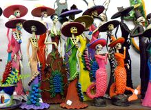 Dia de los Muertos (Day of the Dead) holiday skeletons. Colorful skeleton trinkets in shop, Day of the Dead celebration Royalty Free Stock Photography