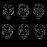 Dia de los Muertos. Day of the Dead sugar skulls. Mexican Dia de los Muertos. Collection of the Day of the Dead sugar skulls calavera on black backround Stock Photos