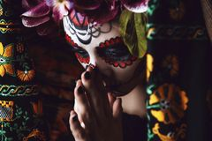 Dia de los muertos. Portrait of a girl with sugar skull makeup over black background. Calavera Catrina. Dia de los muertos. Day of The Dead. Halloween Royalty Free Stock Image