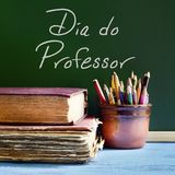 Dia do professor, teachers day in Portuguese. Closeup of a chalkboard with the text dia do professor, teachers day written in Portuguese, a pile of old books and stock photos