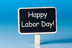 Dia do Trabalhador internacional no texto do dia do 1º de maio em pouco etiqueta de madeira Tempo de mola, dia labour - 1 de pode Fotografia de Stock Royalty Free
