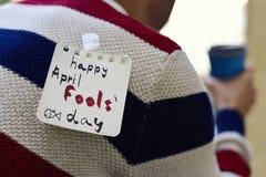 Dia feliz dos enganados do homem novo e do texto Imagens de Stock