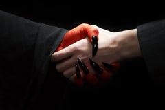 diabeł uścisk dłoni Zdjęcia Royalty Free