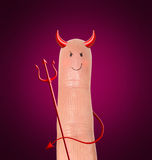 Diabeł na palcu - humoru contept Fotografia Royalty Free
