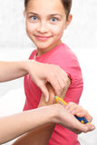 Diabetes, child take insulin. Girl with diabetes during the injections of insulin Stock Image