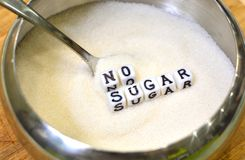 Diabetes concept with no sugar advice to improve health. Health care concept with sugar and letters. Diabetes concept with no sugar advice to improve health stock photo