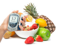 Diabetes diabetic concept glucose meter in hand and healthy orga Stock Photo