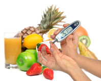 Diabetes diabetic concept. Measuring glucose level blood test. On organic food fruits and vegetables background royalty free stock photos