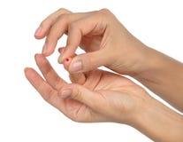 Diabetes diabetic finger prick for glucose sugar measuring level Stock Photos
