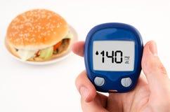 Diabetes doing glucose level test Stock Photos