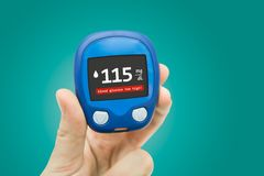 Diabetes doing glucose level test Stock Photo