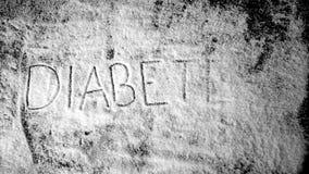 Diabetes escrita en el polvo del azúcar que es soplado ausente almacen de video