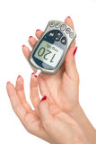 Diabetes measuring glucose level blood test with glucometer Royalty Free Stock Image