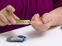 Diabetes. Patient doing glucose level blood test using glucometer Royalty Free Stock Images