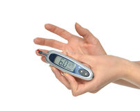 Diabetes patient hands measuring glucose level blood test Royalty Free Stock Image
