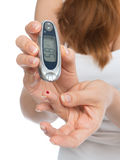 Diabetes patient measuring glucose level blood test with glucome Royalty Free Stock Image
