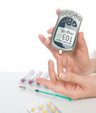 Diabetes patient measuring glucose level blood test Stock Photos
