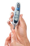 Diabetes patient measuring glucose level blood test Stock Photography