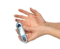Diabetes patient measuring glucose level blood test using ultra Stock Photography