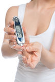 Diabetes patient woman measuring glucose level blood test Stock Image