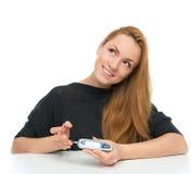 Diabetes patient woman measuring glucose level blood test Stock Photo