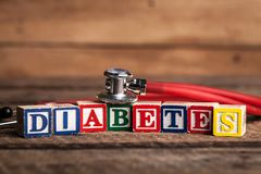 Diabetes and stethoscope. Medecine concept. Cubes stock photos