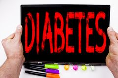 Diabetes text written on tablet, computer in the office with marker, pen, stationery. Business concept for Disease Medical Insulin. White background with space Stock Image