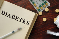 Diabetes written on a book and diagnosis form. stock images