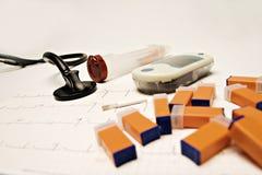 Diabetesausrüstungen und -stethoskop Stockfotos
