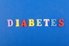 DIABETETES word on blue background composed from colorful abc alphabet block wooden letters, copy space for ad text royalty free stock photos