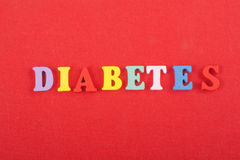 DIABETETES word on red background composed from colorful abc alphabet block wooden letters, copy space for ad text Royalty Free Stock Image