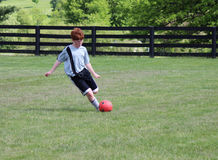 Diabetic Boy playing soccer Stock Image