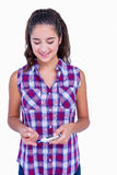 Diabetic brunette using blood glucose monitor Stock Photo
