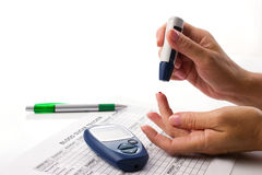 Diabetic concept with glucometer Stock Photos