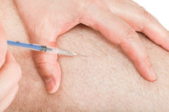 Diabetic insulin injections in the thigh Stock Photography
